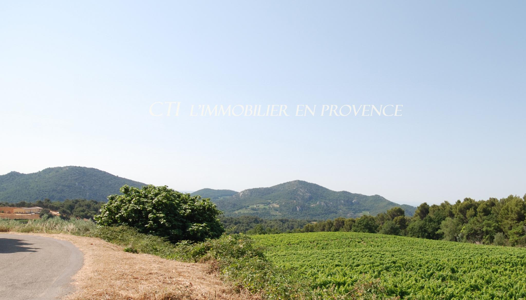 0 www.cti-provence.net A VENDRE PROPRIETE MAS PIERRE DENTELLES DE MONTMIRAIL CHARME VUE COUR JARDIN
